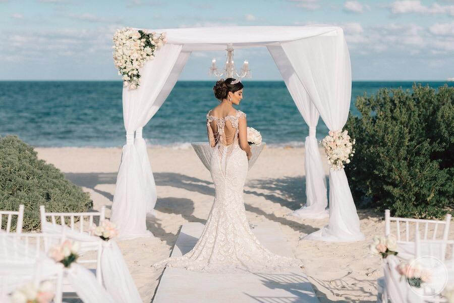bride at the beach by wedding gazebo