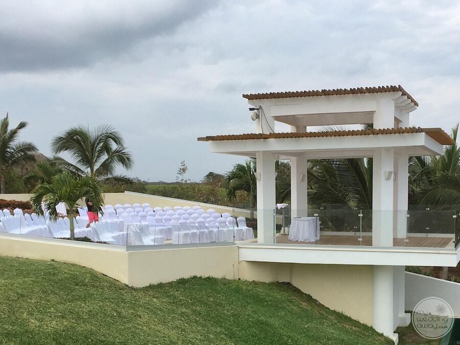 main resort wedding gazebo with white pillars white chairs and palm trees
