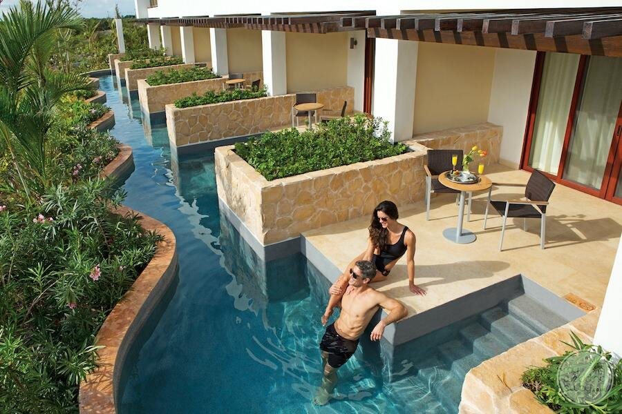 swimout suites with couple sitting by pool