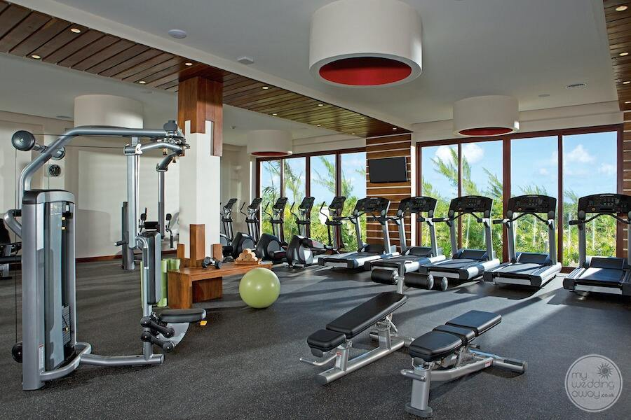 main fitness center with running machines weights and treadmills