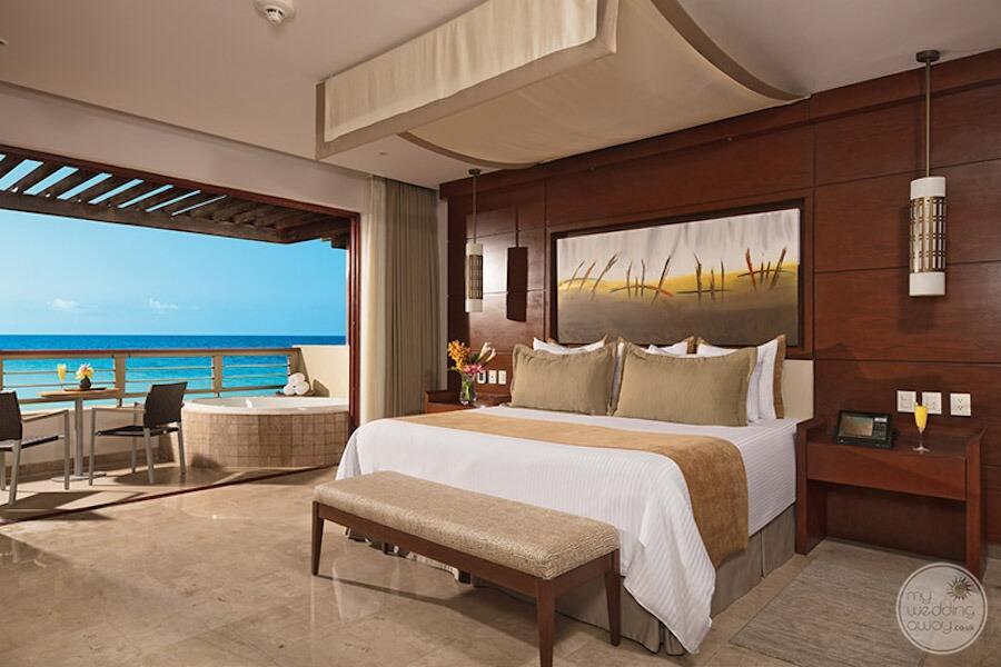 King bed with Junior Jacuzzi suite room with open balcony overlooking the ocean