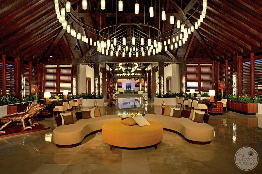 main lobby area with lighted ceiling and yellow couches and chairs