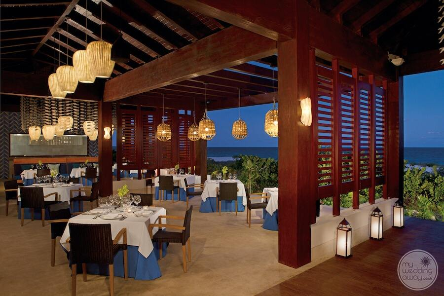 Oceana seafood restaurant in the evening overlooking the ocean with a beautiful dark blue Decor and marble floors