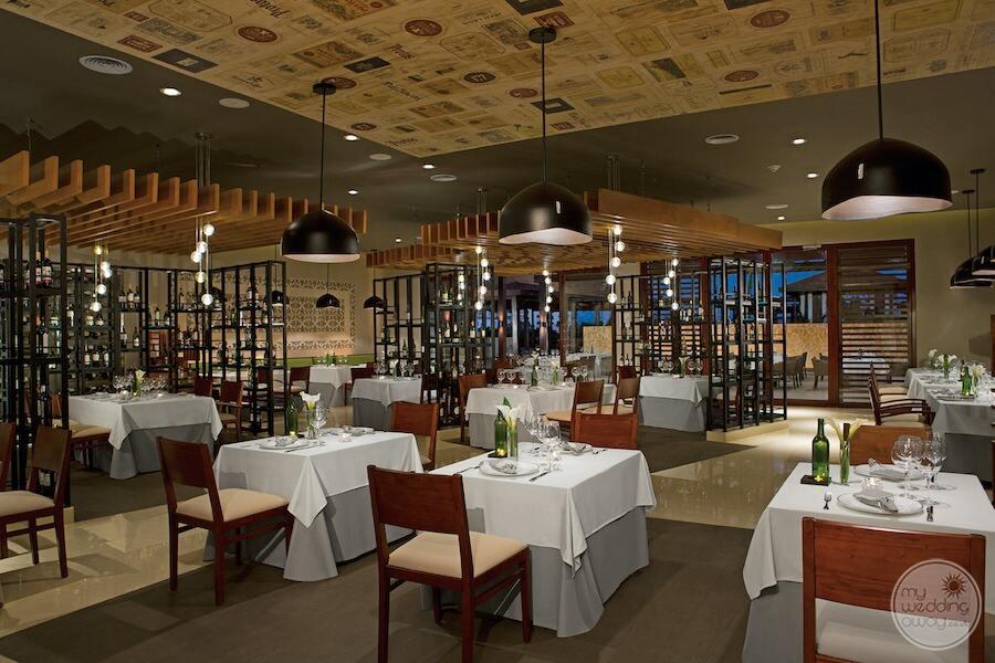 portofino Italian restaurant with soft lighting lowered ceilings and beautiful white tableware