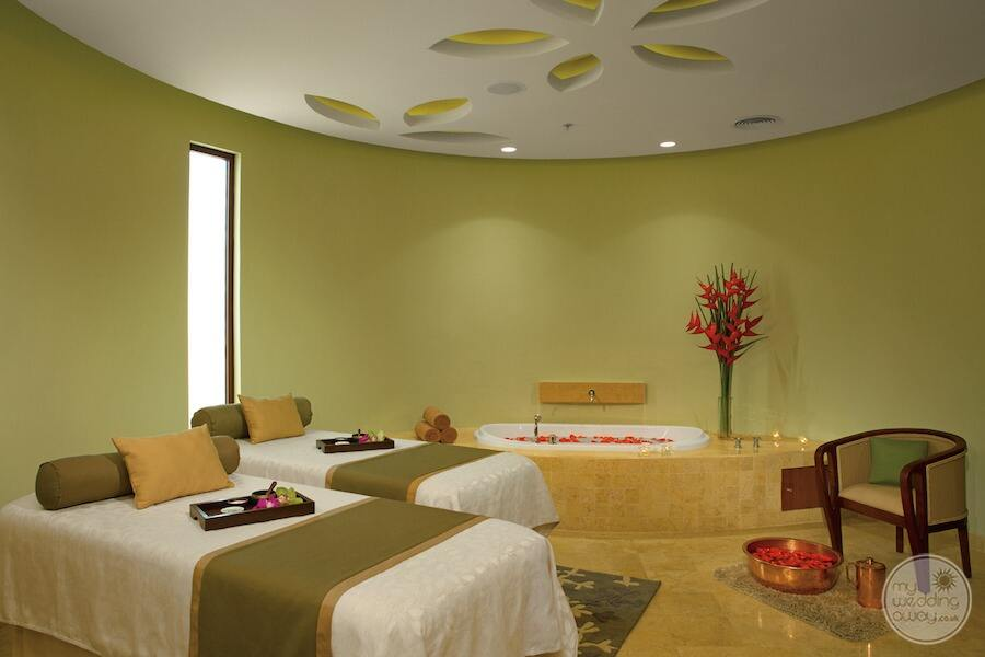 couples massage table is located in the couples massage room with Jacuzzi in the spa