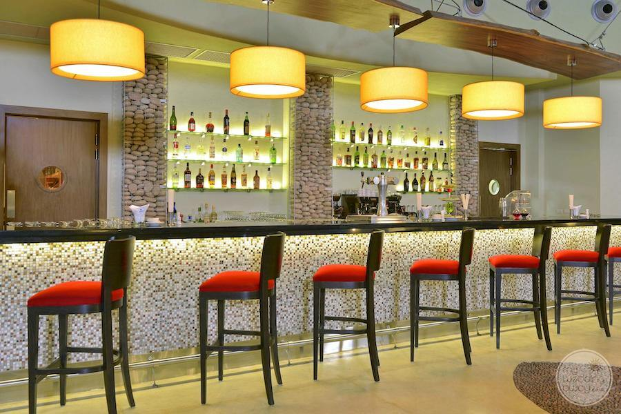 indoor bar with upgraded look yours on the ceiling wall lamps and red velvet chairs