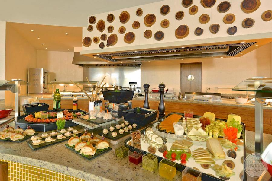 buffet restaurant with a different pastries cheeses and hams on display