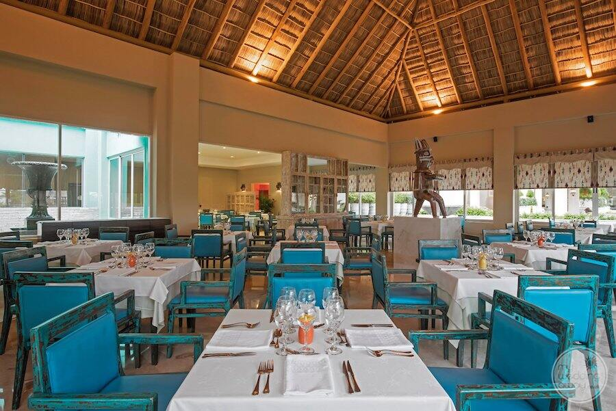 main buffet restaurant was blue leather chairs and high-volted ceiling
