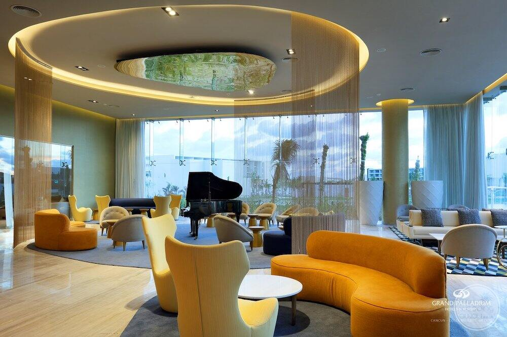 Lobby area with grand piano soft seating and beautiful lighting
