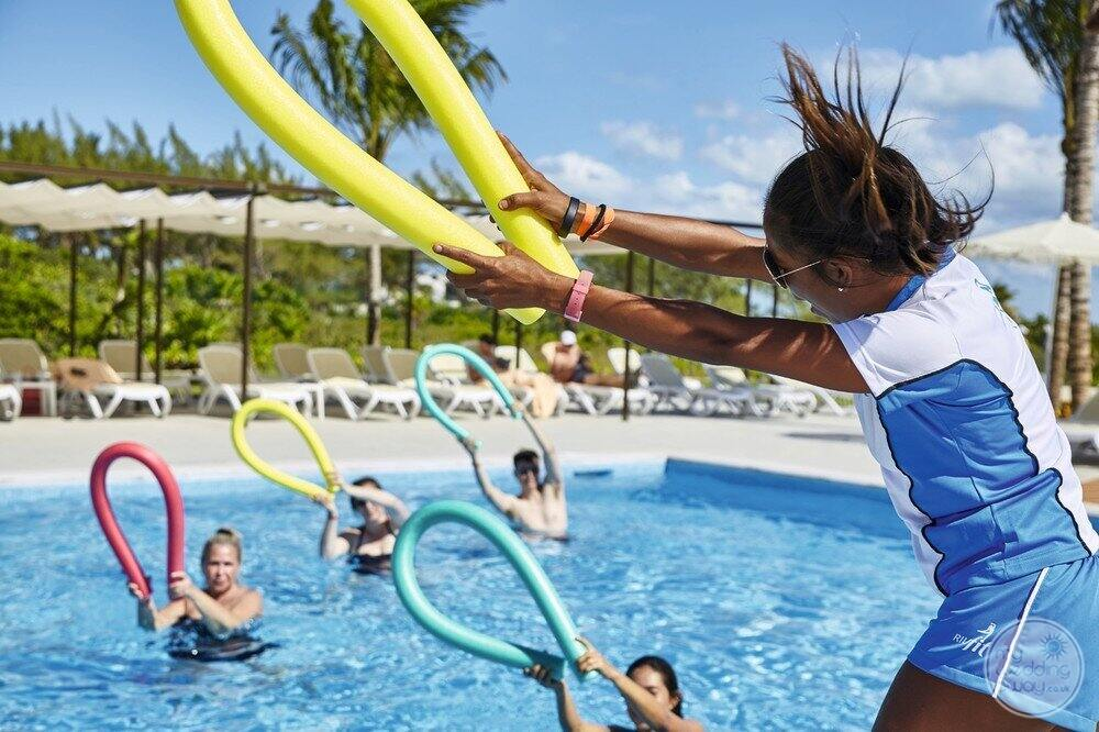 Resort guests enjoying activity in the water with staff
