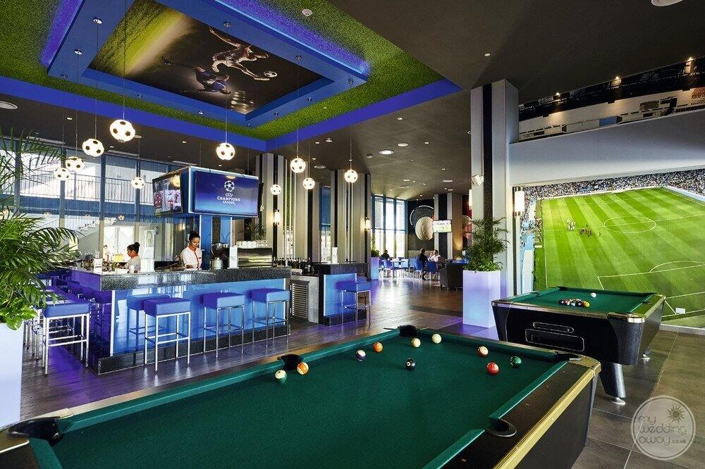 Recreation area with pool tables television sets and bar