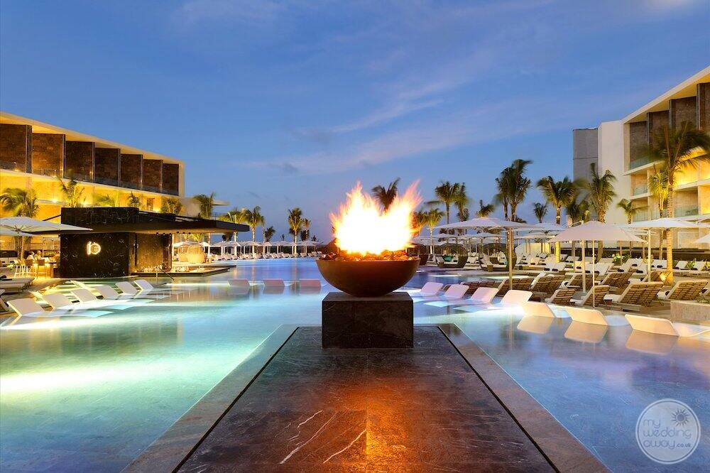 Fire structure located in the main pool area at sunset