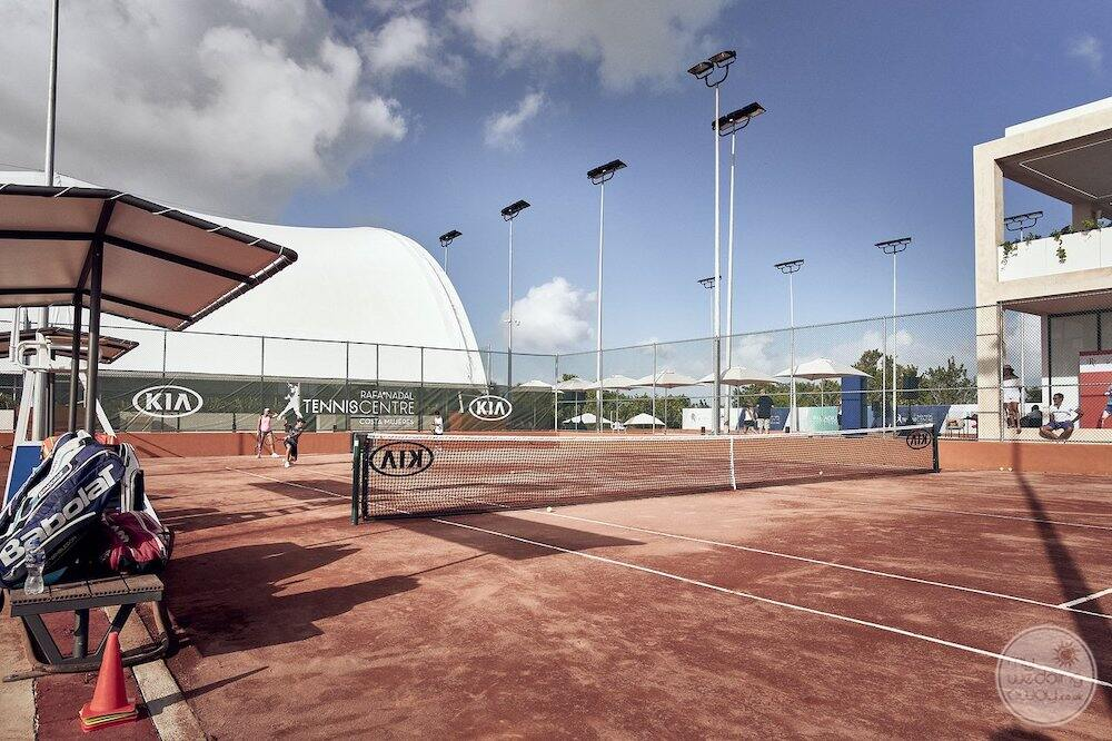 Main outdoor tennis area with sand court