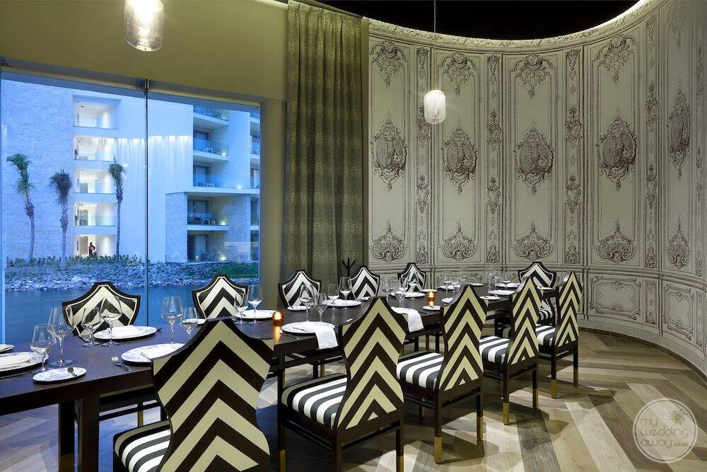 French restaurant with black and white stripes chairs and