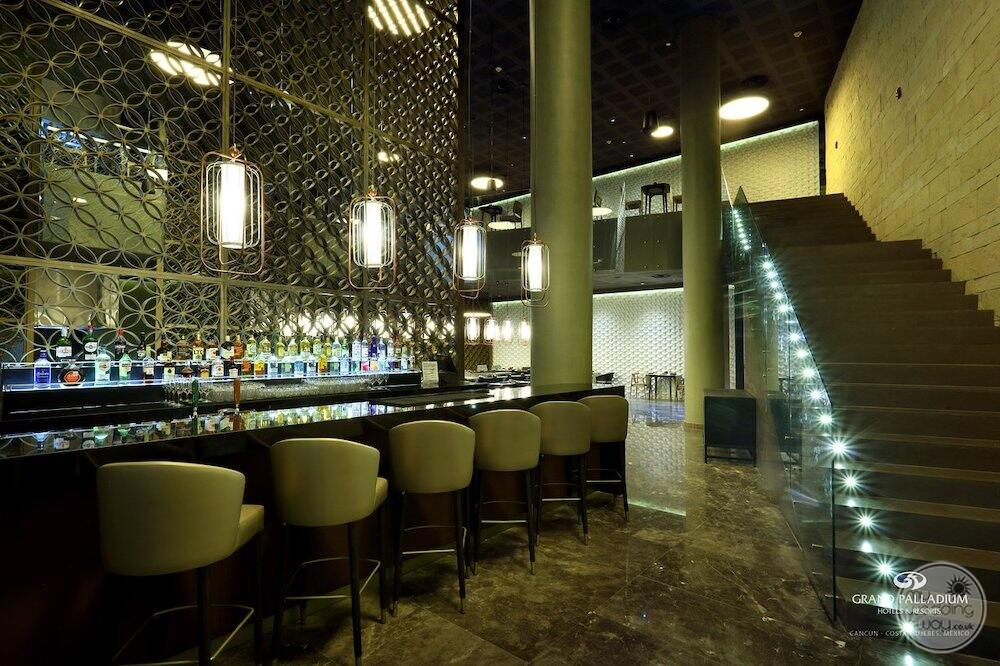 sumptuori japanese restaurant with light green shares and upscale bar and top shelf drinks
