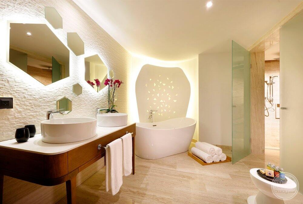 Bedroom bathroom with a white Sokoto double sink vanity and marble floors