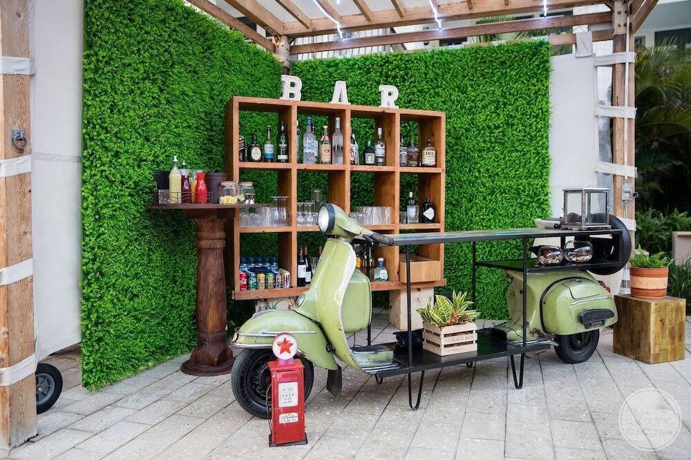 outdoor bar service area with cool motorcycle set up