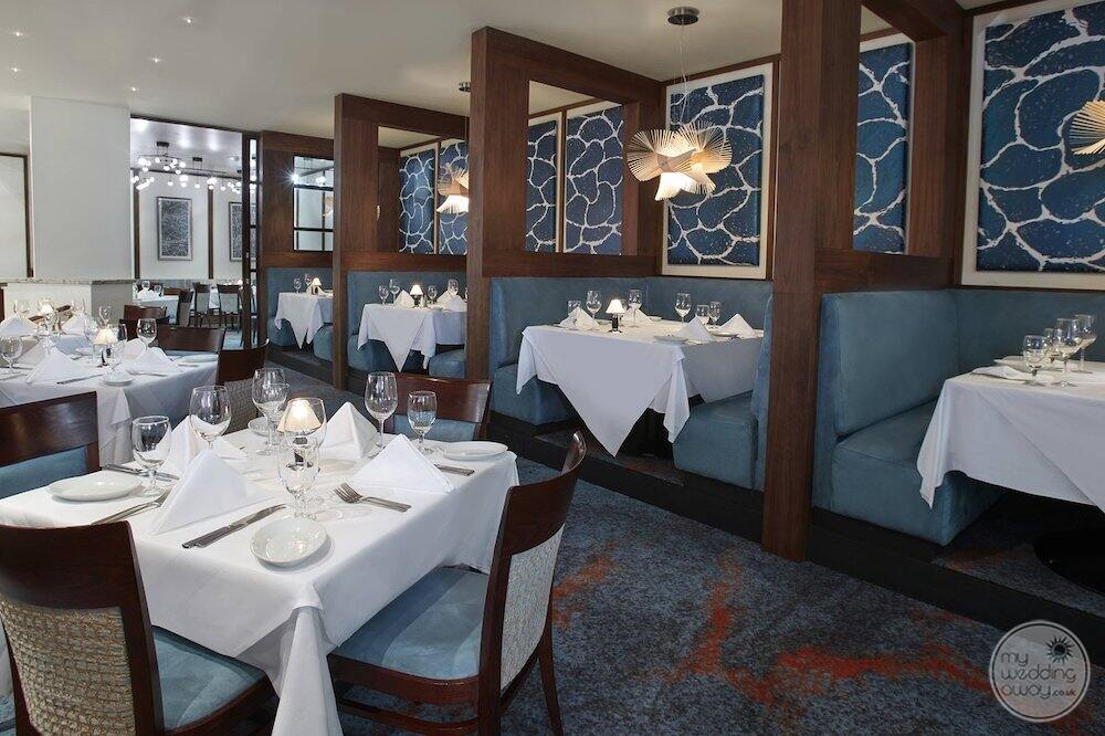 restaurant with blue leather seating banquet stalls
