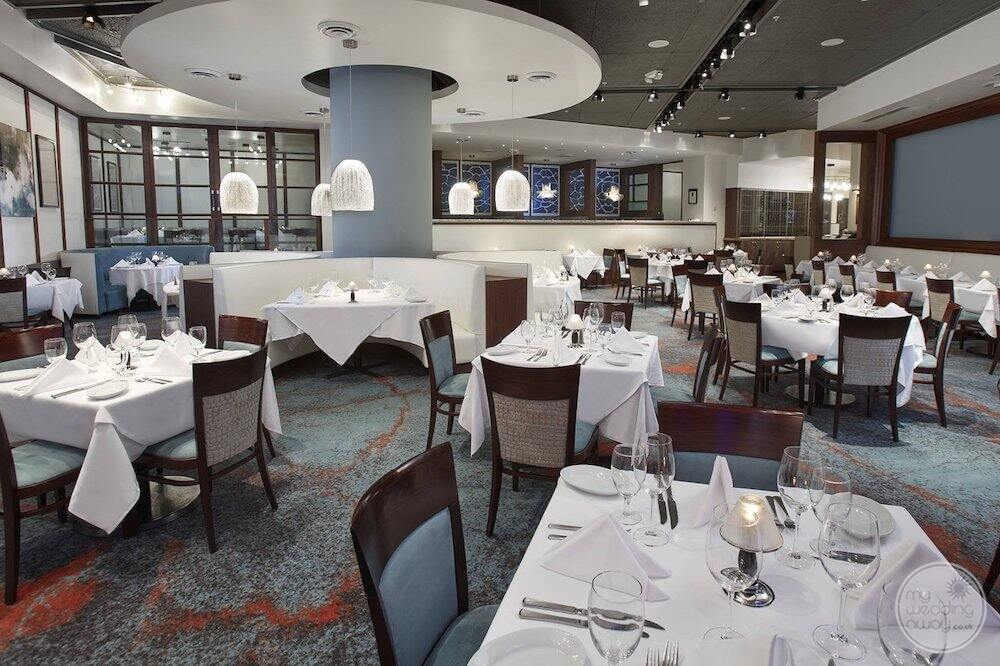 main dining room restaurant was spacious ceiling and white linen decor