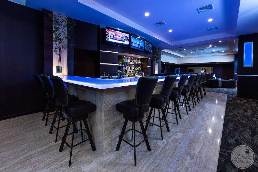 main lobby bar with liquors on the wall