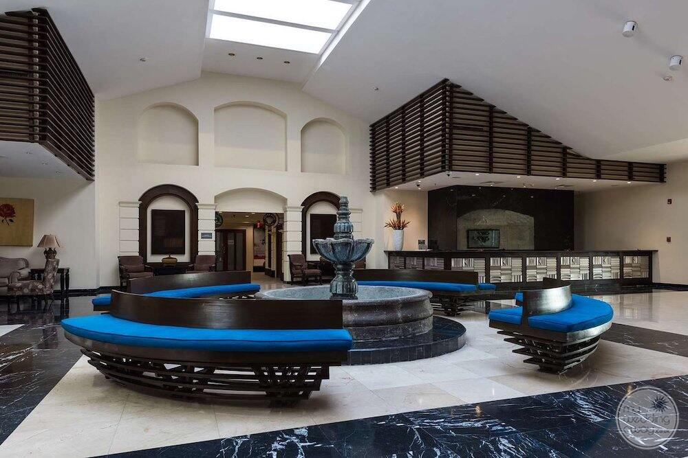 lobby reception area with blue couch seating and water fountain