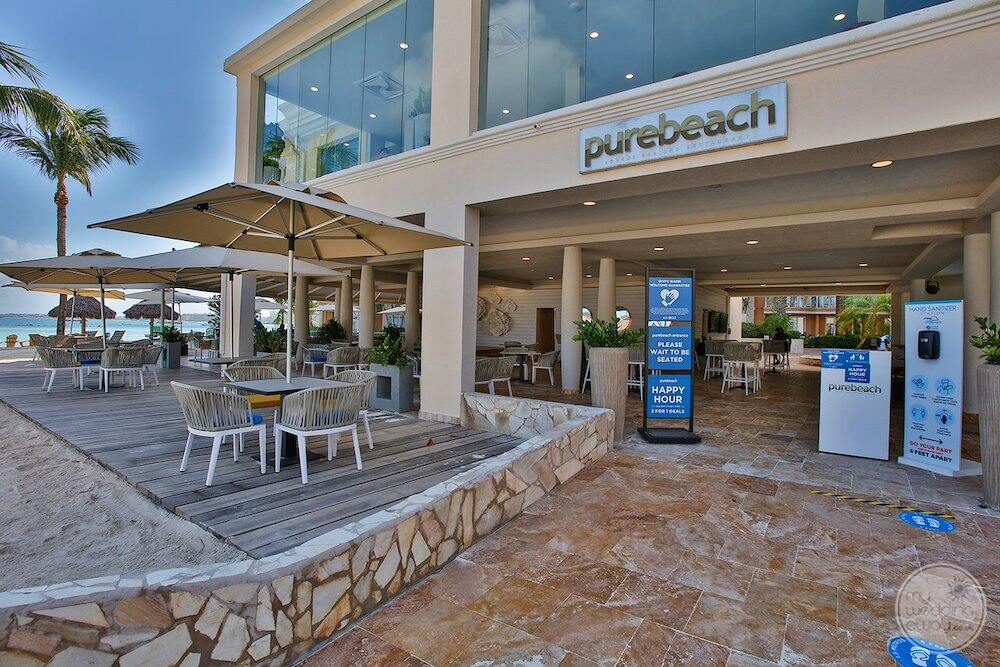 Purebeach Area with tables and chairs and stone tiling