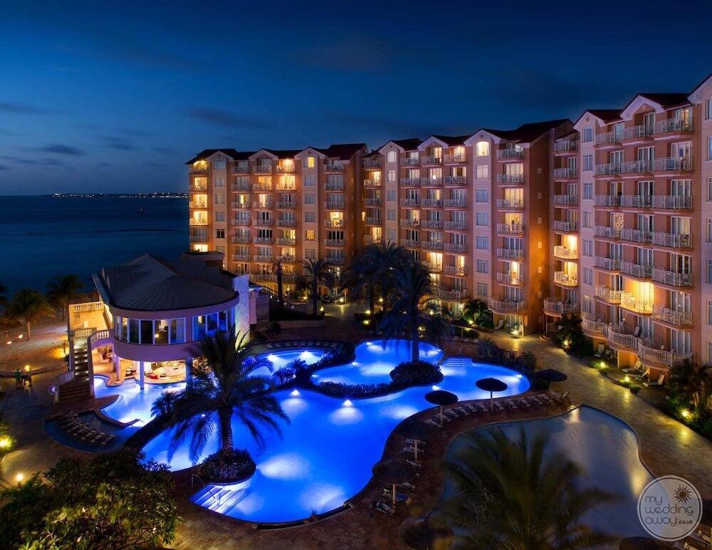 Aerial view of room buildings main pool swim up bar at night
