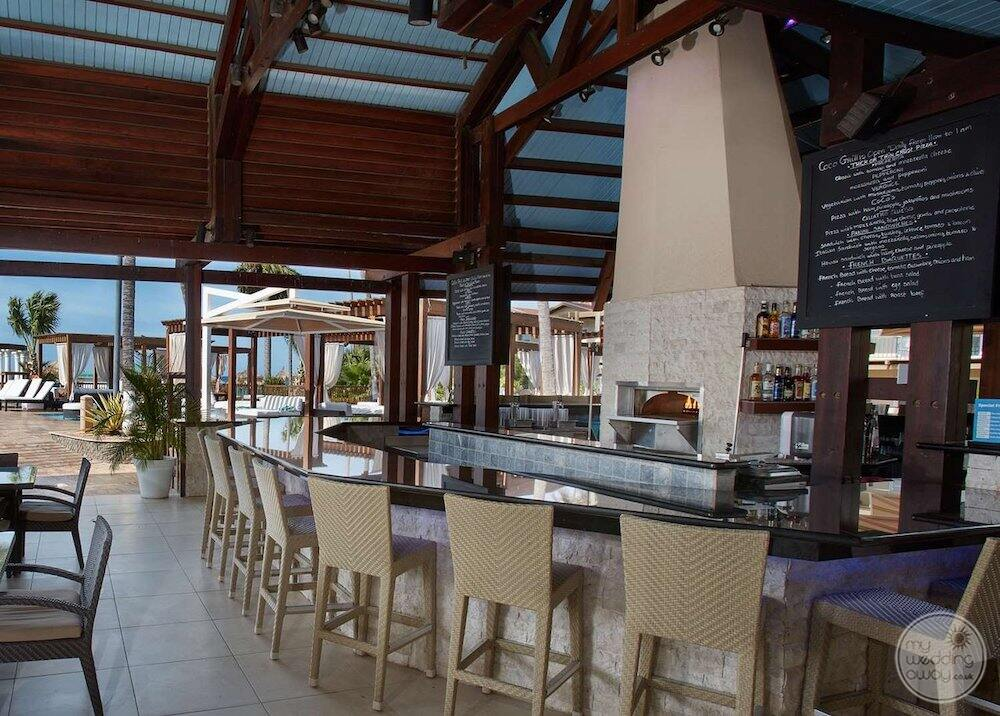 Coco grill area where guest can enjoy a drink and lunch by the beach