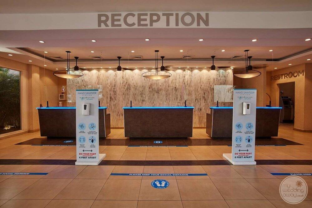 Main lobby reception area with marble floors