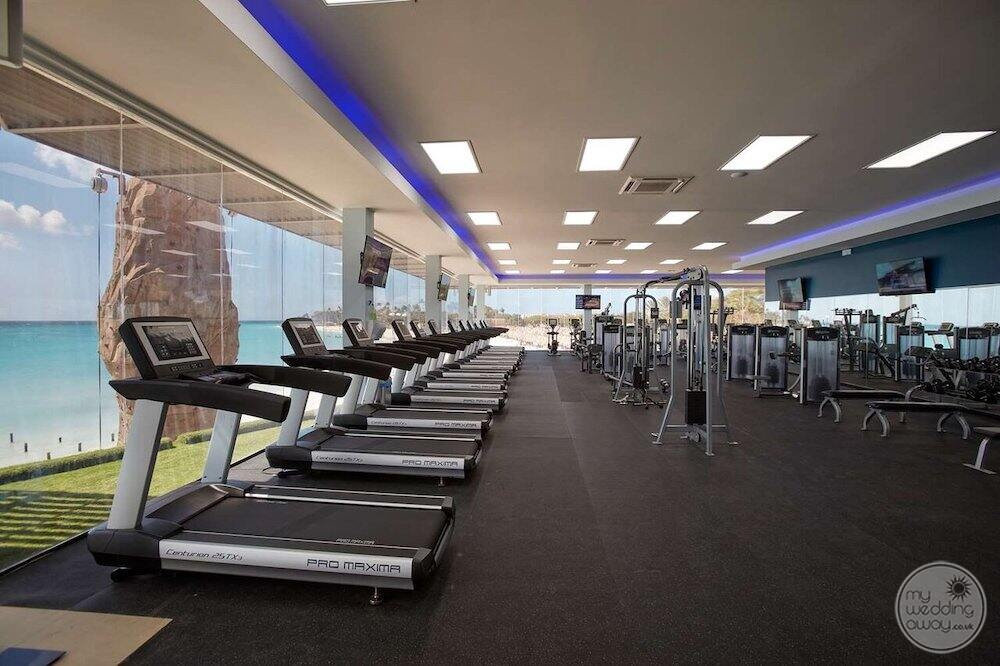 Oceanfront fitness centre with treadmills weights and weight machines