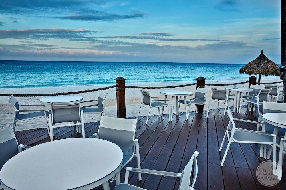 Pelican bar and terrace located right at the beach with ocean in the background