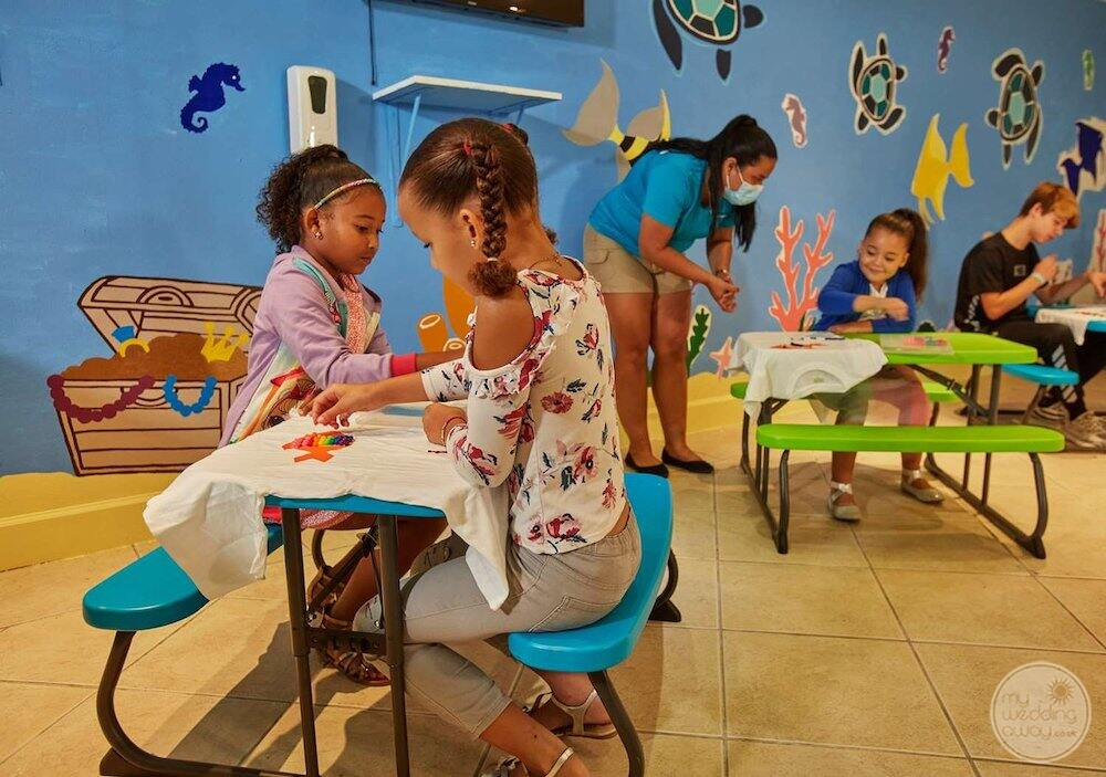 See turtles children's club with small children doing activities with resort staff