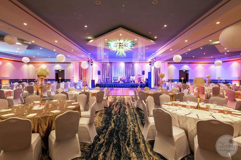 main ballroom with the course sitting set up for wedding reception