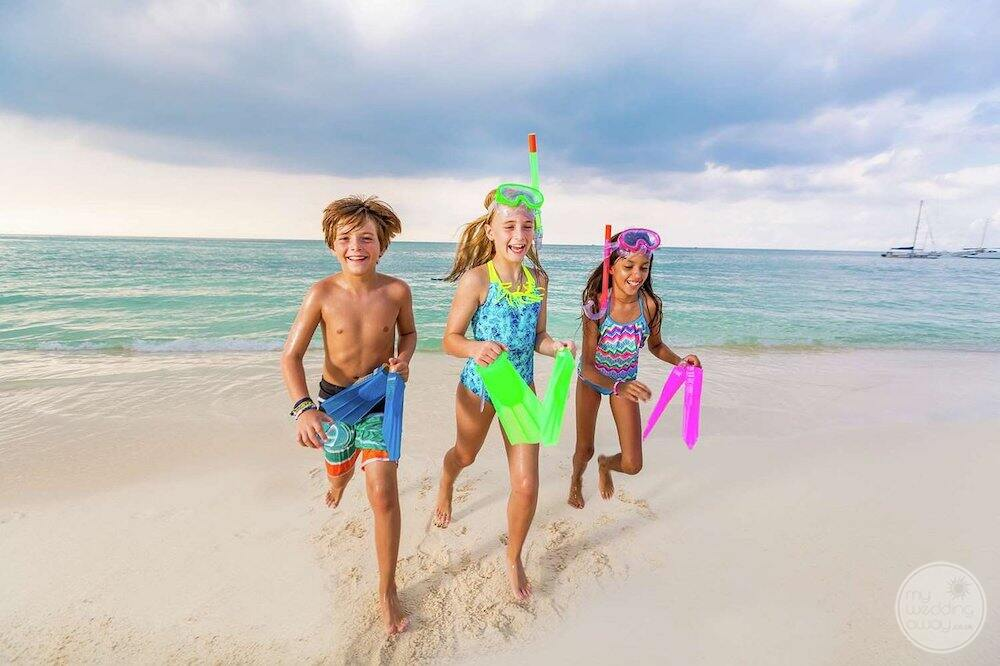 Watersport activities on the beach with children with snorkel gear