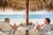 Hilton-Aruba-Caribbean-Resort-Spa-couple-drinks-on-the-beach