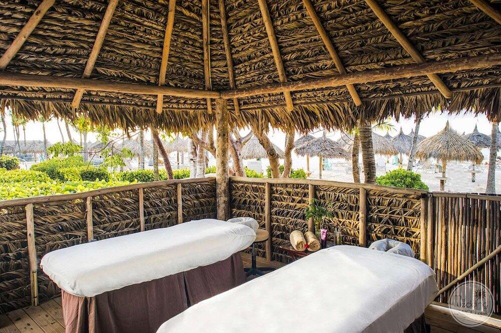 couples massage area and cabana overlooking the beach
