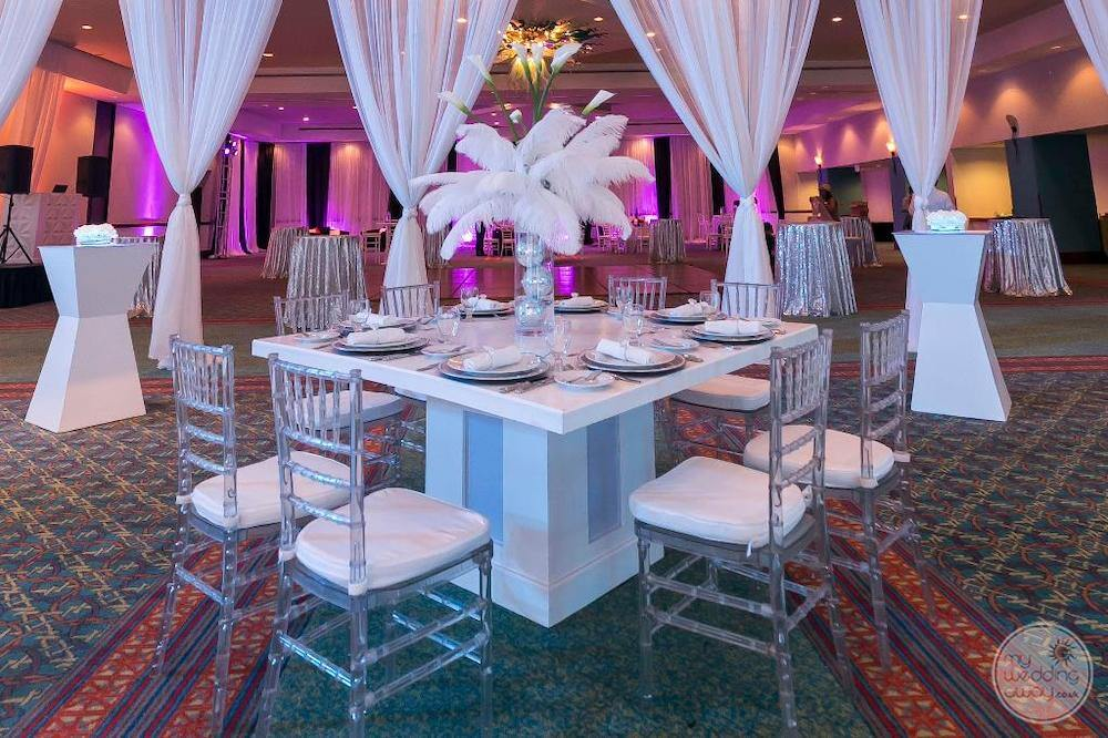 Grand cru be in ballroom with table set up and a coffee for wedding reception