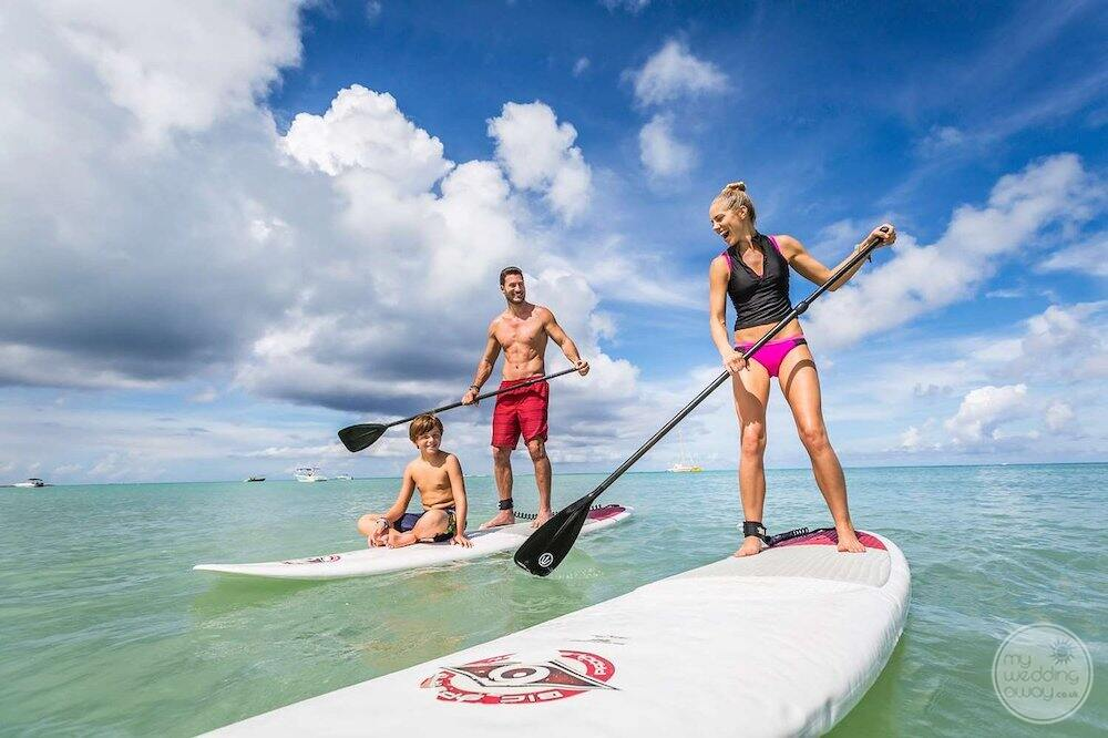 Ocean sports with guest  using paddle boards from the resort
