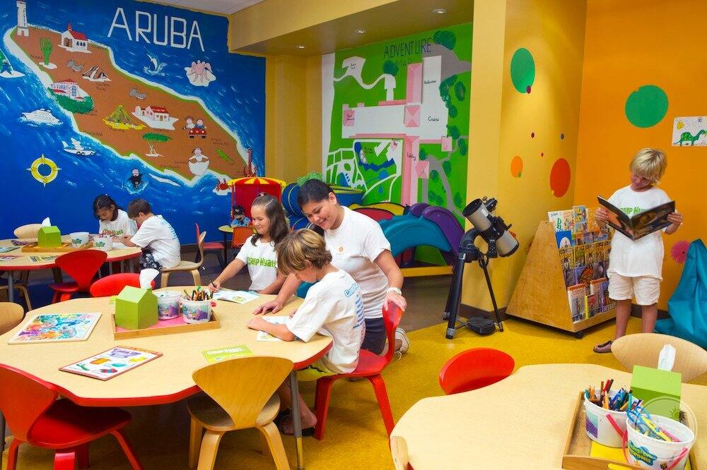 Can't hire children centre with children sitting at a table doing crafts and activities