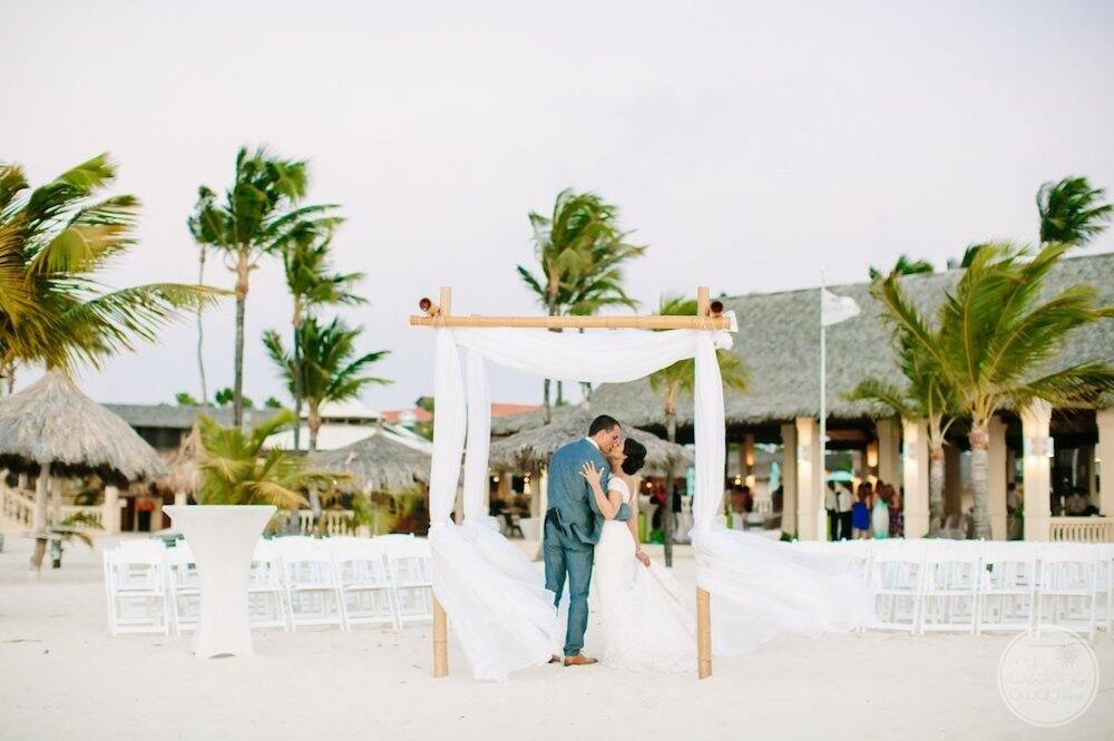 Wedding couple in embracing by the beach gazebo on the beach