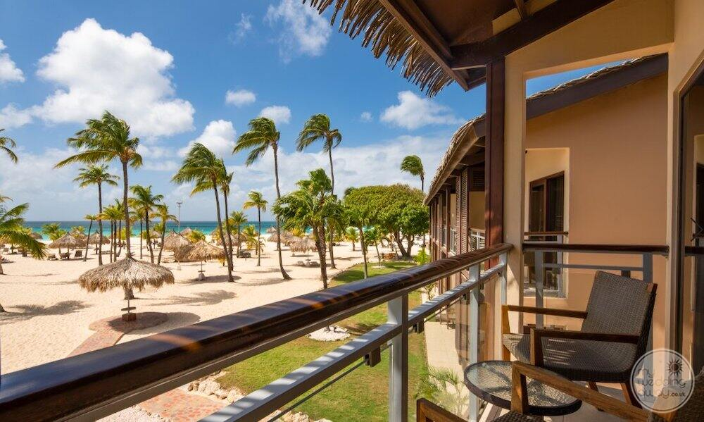 In view of our deck of ocean view room with View of the beach and palm trees
