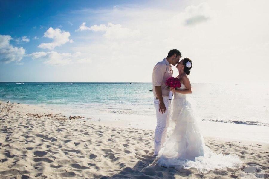 wedding couple on the beach holding hands near Sunset