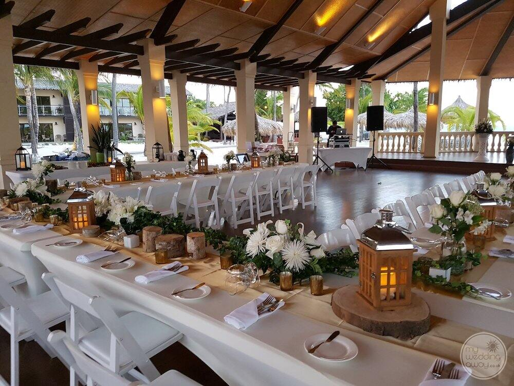 Wedding reception set up inside with a beautiful white flower and lamp decor