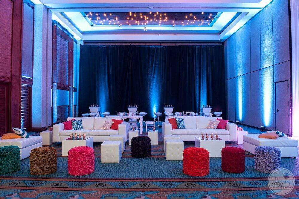 lounge area in the casino with a beautiful white leather chairs and colourful seats