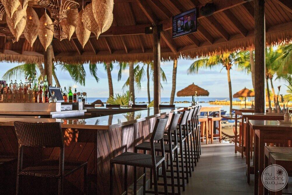 outdoor bar area with sitting close to the ocean