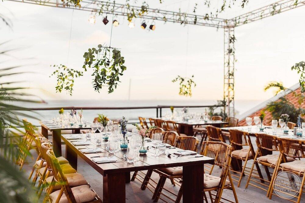 outside deck Terrace wedding venue set up with a beautiful seating flowers and view of the ocean
