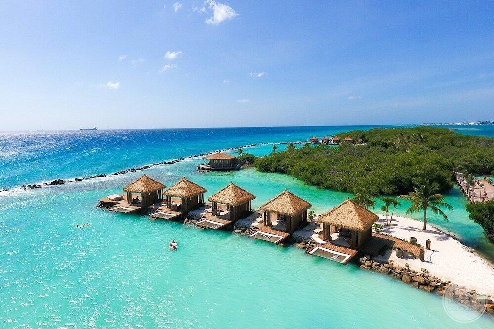 overwater bungalows with the ocean in the background