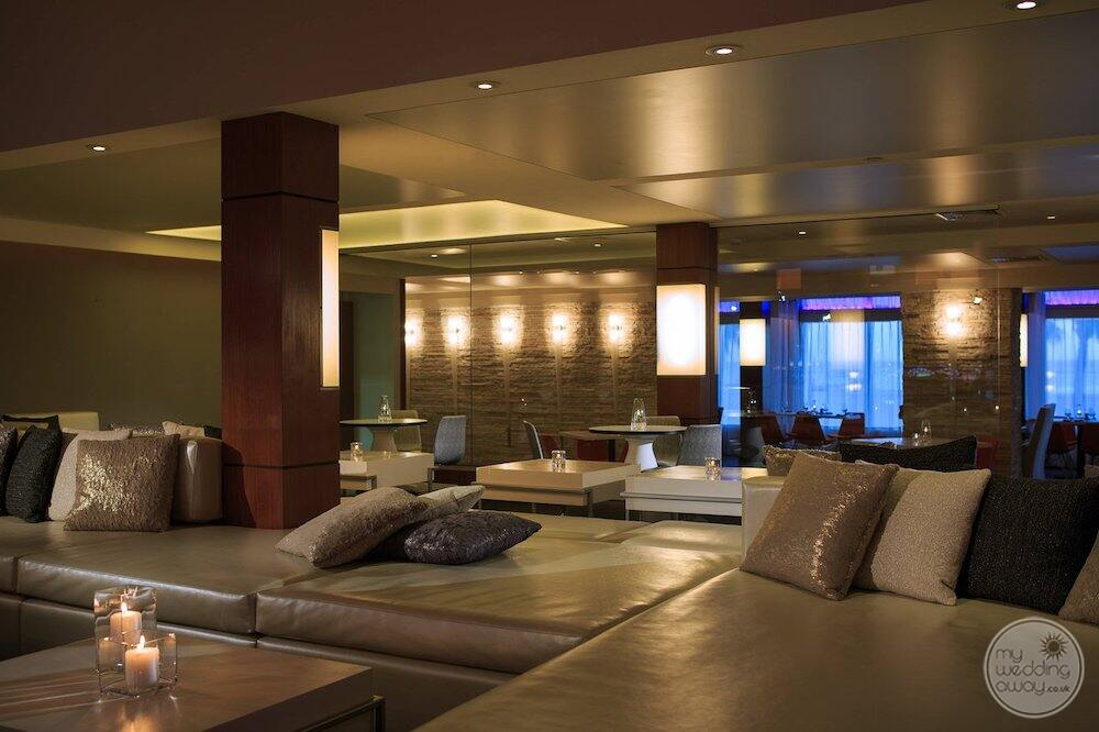 Area in the spa with beautiful brown leather couches pillows
