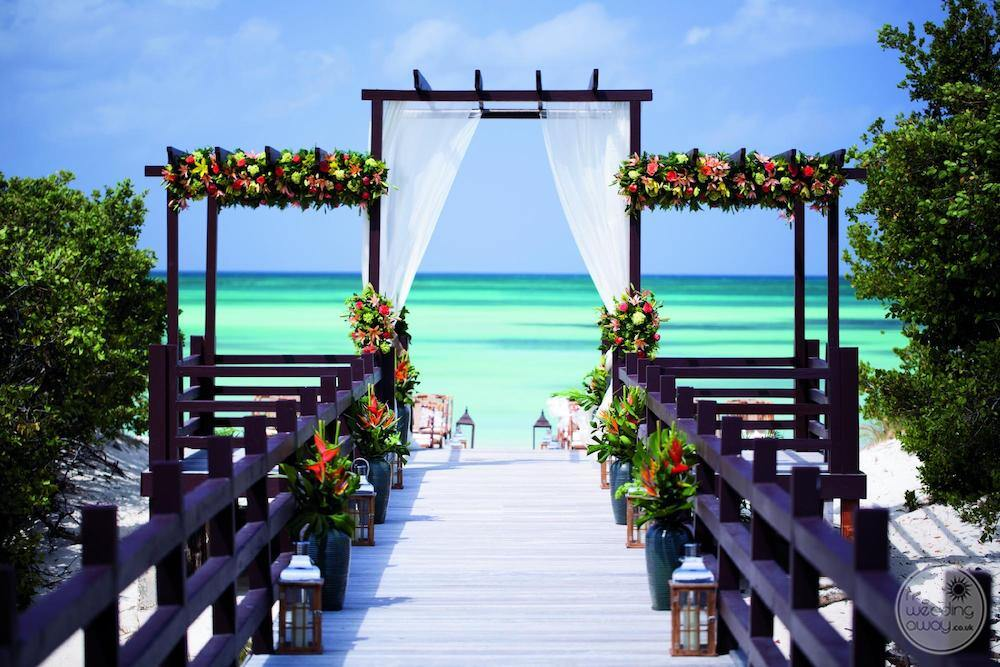 Wedding ceremony set up with floral decorations, Close to the beach