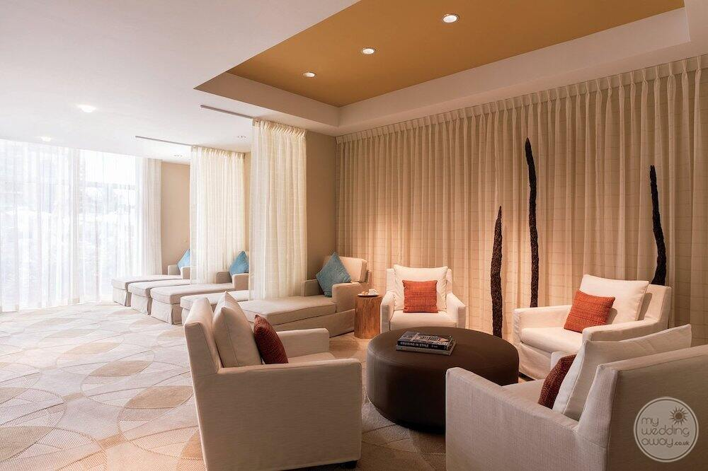 Area of the spa with lounge chairs and lounge couches